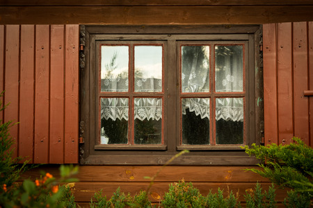 Dirty windows and shutters in the wooden house the countryside