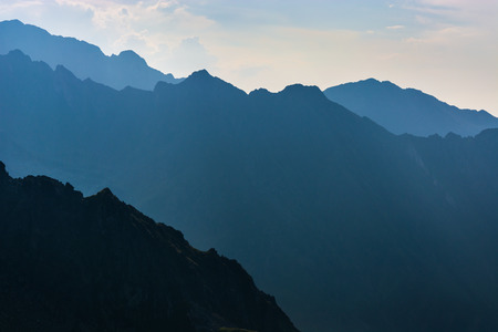 mountainside: Mountains in the evening, dark mountainside with the evening light Stock Photo