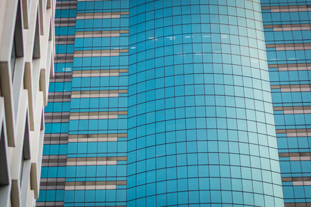 Blue windows in office building in Bangkok, Thailand