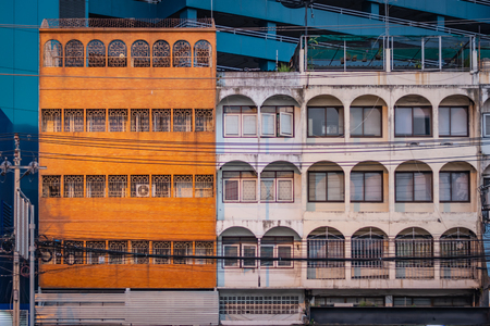 Orange and white facades of buildings in Bangkok, Thailand