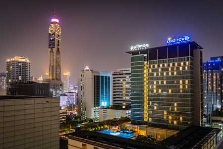 BANGKOK, THAILAND - NOVEMBER 2018: Bangkok lights at night - skyscrapers, windows and roof pool in Thailand