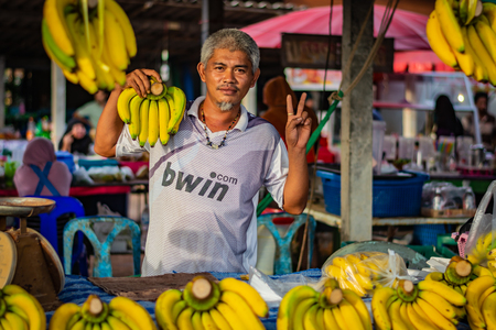 KOH LANTA, THAILAND - NOVEMBER 2018: The banana seller at Koh Lanta in Thailand