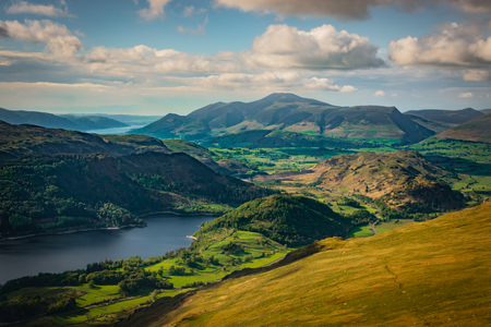 Green valley and Thirlmere Lake seen from Helvellyn in the English Lake District, sunny day, hills and mountains