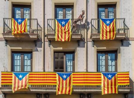idioms: Catalonian flags on balconu in Barcelona Spain Stock Photo