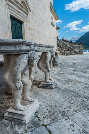 titans: Stone table, which stands on two carved titans, Perast