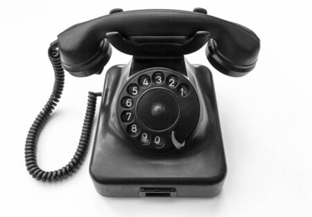 Old telephone isolated on white background , black and white