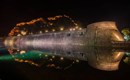 Kotor fortress wall and Old Town by night