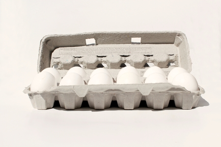 dozen: egg crate, dozen eggs, isolated on white.