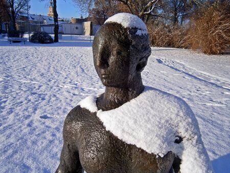 The snow mantle of a bronze statue of Stock Photo - 16968470