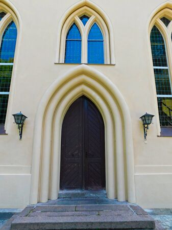 Entrance portal of the 18th century protestant cruciform church