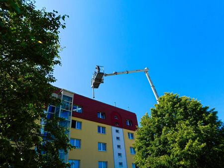 Templin, Brandenburg district Uckermark / Germany - July 24, 2019: Antenna work with a hoist on the house Stock Photo