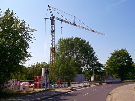 Templin, Brandenburg district Uckermark / Germany - July 28, 2019: The yellow crane on a construction site in Templin