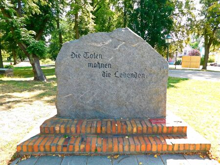 Memorial stone with the inscription, The dead admonish the living!
