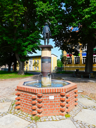 Joachimsthal, Brandenburg County Barnim / Germany - 06 June 2019: Fountain with the statue of the Elector Joachim Friedrich of Brandenburg, the founder of the city of Joachimsthal.