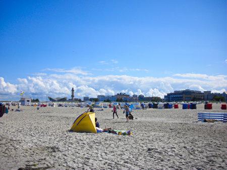 Warnemünde, Mecklenburg-Western Pomerania / Germany - August 20, 2013: Vacation on the Baltic Sea beach of Warnemünde Publikacyjne