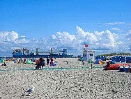 Warnemuende, Mecklenburg-Western Pomerania / Germany - August 20, 2013: Vacation on the Baltic Sea beach of Warnemuende Publikacyjne