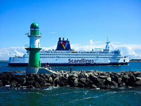 Warnemünde, Mecklenburg-Western Pomerania / Germany - August 20, 2013: Scandlines hybrid ferry Berlin in the port entrance Publikacyjne