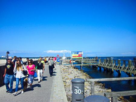 Warnemünde, Mecklenburg-Western Pomerania / Germany - August 20, 2013: People on the harbor promenade at the old river