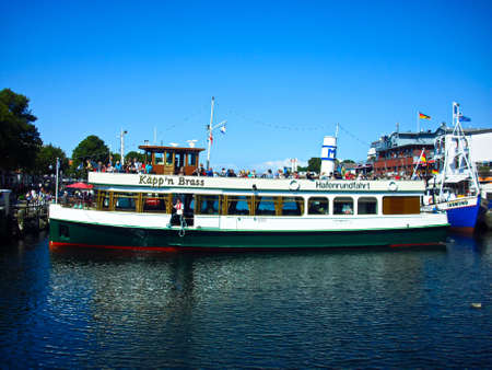 Warnemünde, Mecklenburg- Western Pomerania / Germany - August 20, 2013: Ships in the old stream Publikacyjne
