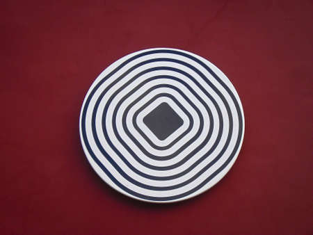 A round disc with optical illusion
