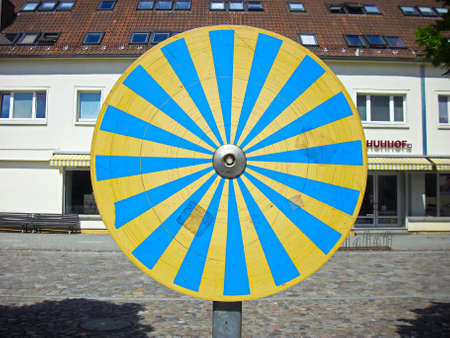 Rotary wheel for optical illusion on the market square