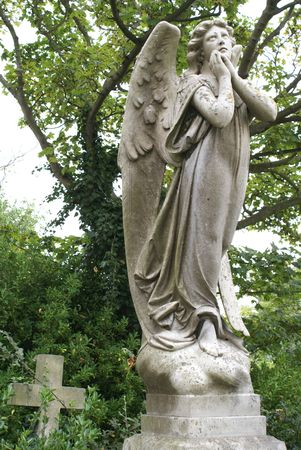 angel headstone: Mourning angel and cross