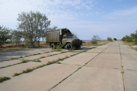 Russian military truck on remote air force station photo