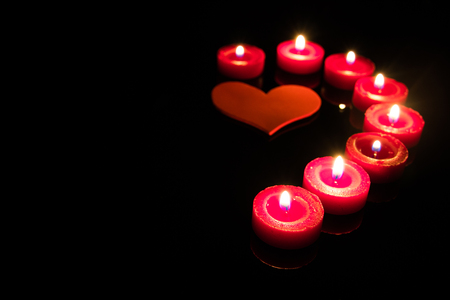 Red hearts and red candles Saint Valentines concept Stock Photo