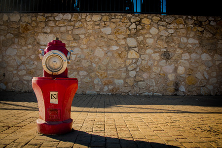 Fire hydrant on the street.Red colour Banque d'images - 93137393