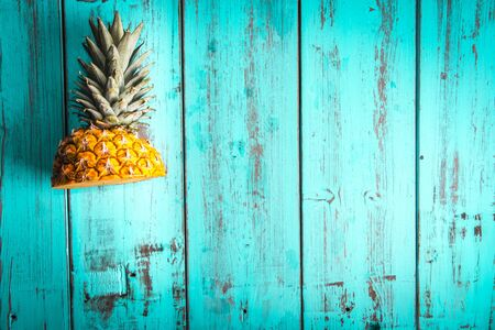 Pineapple cut on a blue background. Except healthy and fresh food