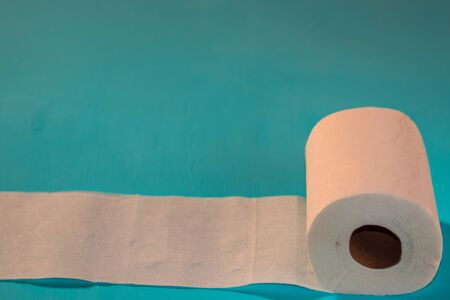 Toilet paper, on light blue background Stock Photo