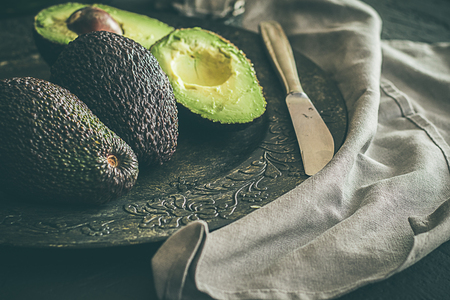Whole avocados, on dark grey background Stok Fotoğraf