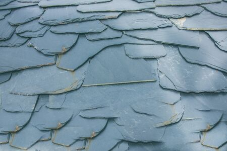 Texture of a slate roof. Roof of a house Stock Photo