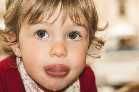 Little girl with her tongue out
