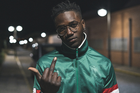 Guy handsome African American black gesture middle finger fuck you