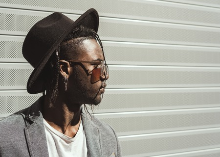 Handsome african american guy profile portrait with street style. Black guy in the city