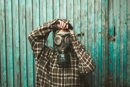 Person wearing a gas mask. Contamination and Pollution Concept 版權商用圖片