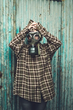 Person wearing a gas mask. Contamination and Pollution Concept Stock Photo