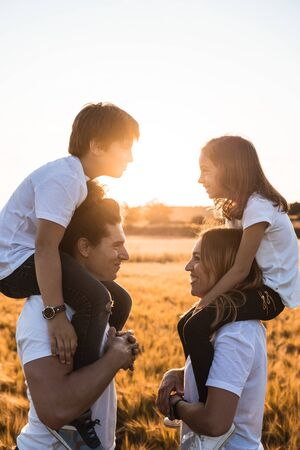 Portrait of a happy and fun family in the countryside. Concept of love family