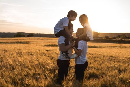 Portrait of a happy and fun family in the countryside. Concept of love family Reklamní fotografie - 124997295