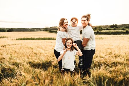 Portrait of a happy and beautiful family playing in the countryside. Concept of family having fun Archivio Fotografico - 126914561