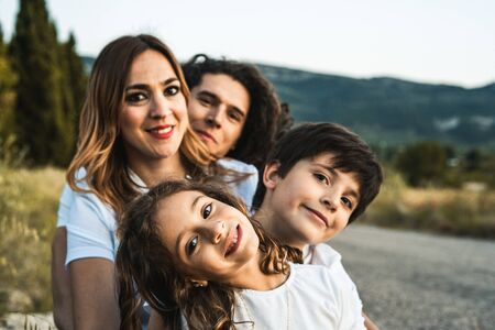 Portrait of a happy and funny young family outdoors.Family lifestyle concept Zdjęcie Seryjne - 126914571