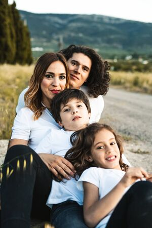 Portrait of a happy and funny young family outdoors.Family lifestyle concept