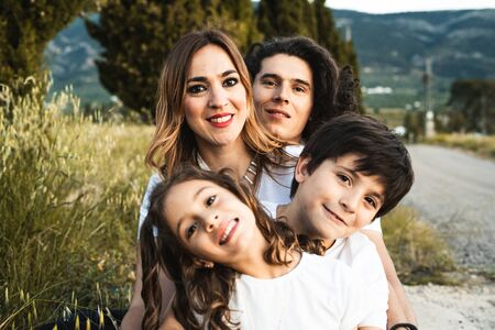 Portrait of a happy and funny young family outdoors.Family lifestyle concept Zdjęcie Seryjne - 126914899
