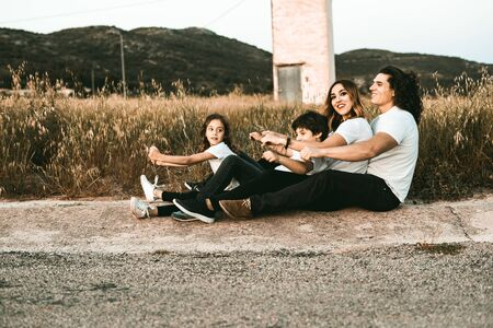 Portrait of a happy and funny young family outdoors.Family lifestyle concept Archivio Fotografico - 126914901