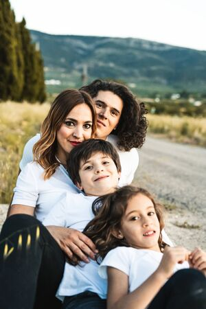 Portrait of a happy and funny young family outdoors.Family lifestyle concept Archivio Fotografico - 126914902