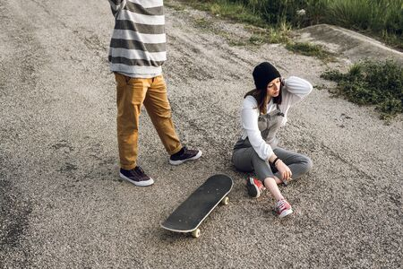 Young couple with casual style riding a skateboard. Young urban lifestyle millennial