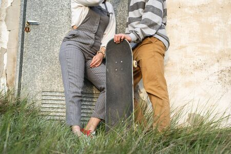 Portrait of a young couple with modern style smiling and happy. Millennial youth concept