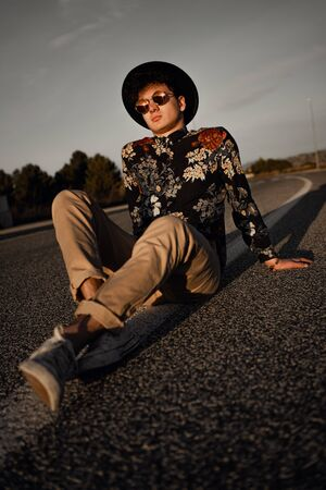Portrait of a stylish modern guy on the road. Concept of young lifestyle Archivio Fotografico