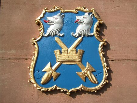 Coat of arms with wolves and swords photo